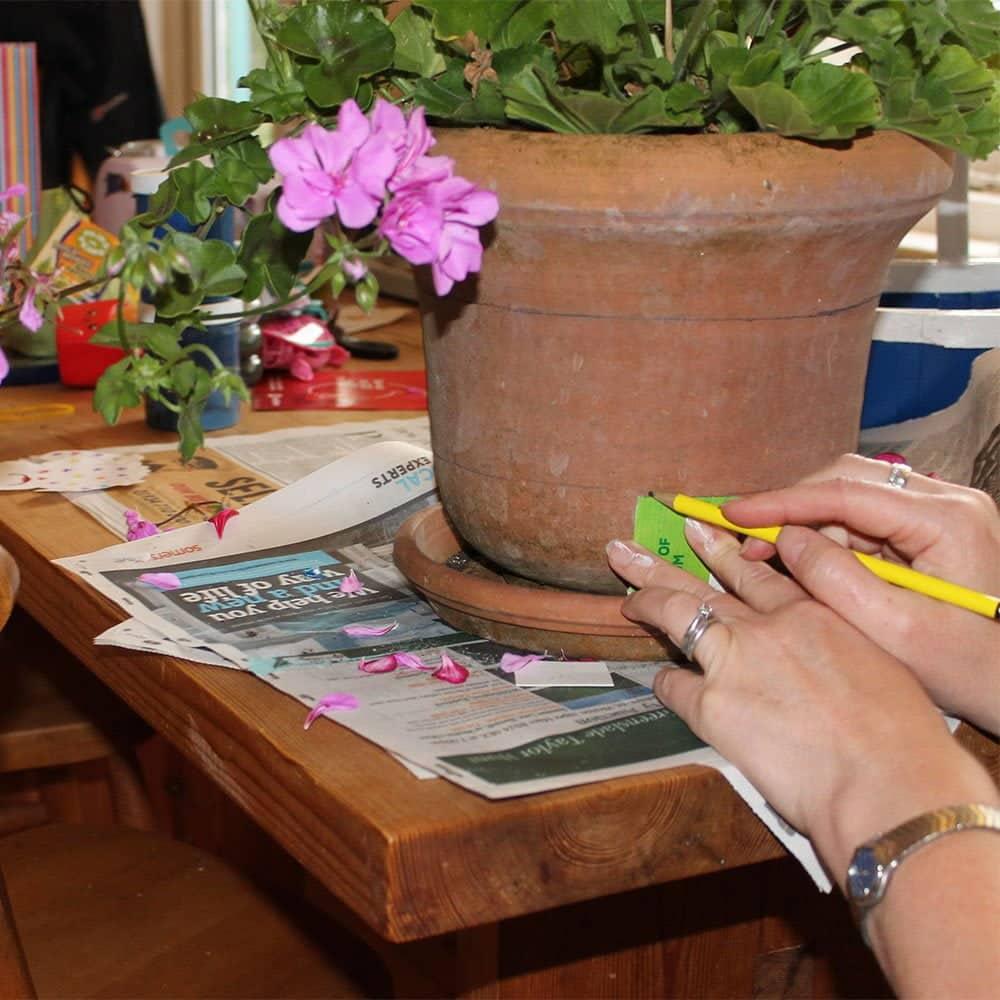 Marking-lines-on-terracotta-pot