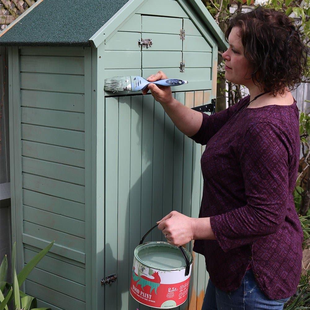 Naomi-Slade-paints-garden-shed-credit,-(c)-Holly-Wlaznik