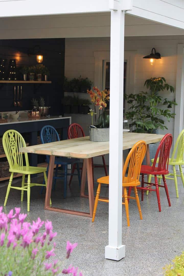 LoveYourGardenSeries9-Chairs-Gromwell-Green,-Bilberry-Blue,-Sundowner-Orange-&-Rowan-Berry-Red-with-Bishop-Blue-&-Greymond-summerhouse