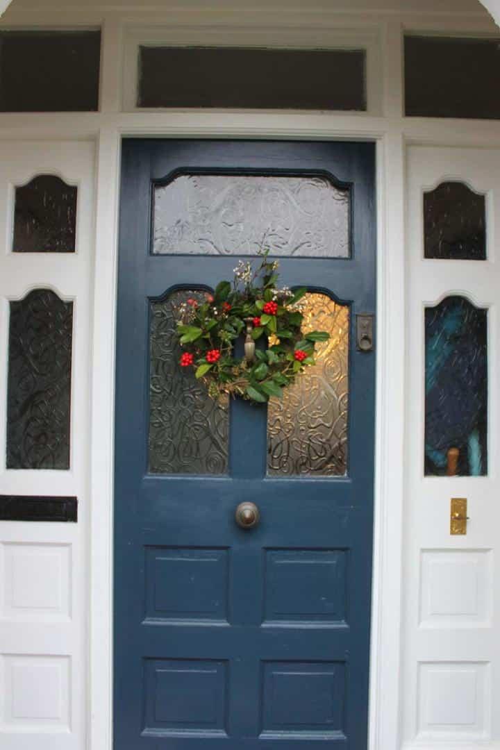 Thorndown-Bishop-Blue-Wood-Paint-front-door-with-Christmas-wreath