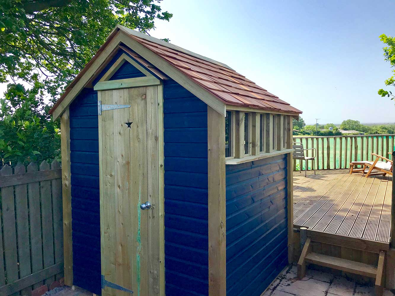 Thorndown-Bishop-Blue-Wood-Paint-on-Wood-and-Space-shed-in-garden